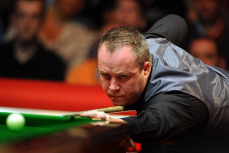 John Higgins suffered a shock first round defeat to Ken Doherty in the Welsh Open.