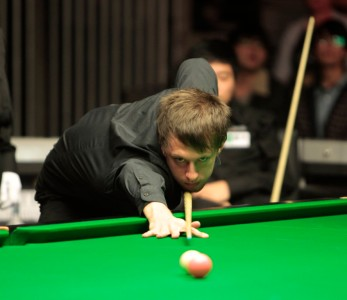 Judd Trump fought back from a precarious position to beat Barry Hawkins.