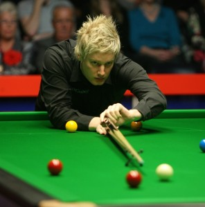 Neil Robertson is through to the quarter-finals of The Masters after beating Ding Junhui 6-5 on Sunday.