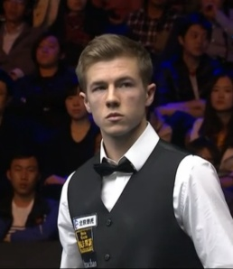 Jack Lisowski produced the result of the day to knock world number one Judd Trump out of the China Open.