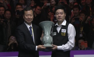 Ding Junhui is handed the International Championship trophy. Picture from CCTV, China.