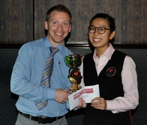 Ng On Yee collects the UK championship trophy. Picture by Mark Jones