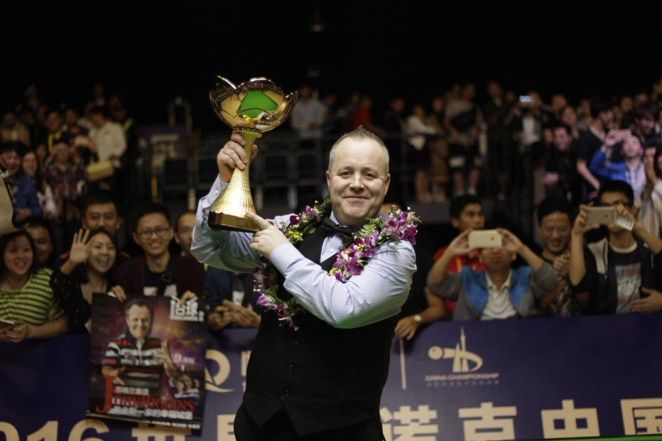 John Higgins lifts China Championship trophy.  Picture - World Snooker